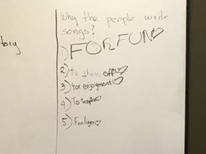 Photo of whiteboard, kids answers to why people write songs