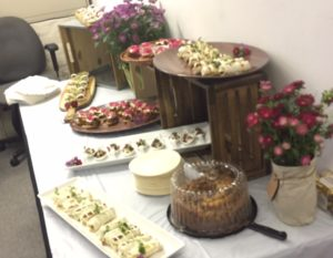 Photo of a table filled with food and flowers.